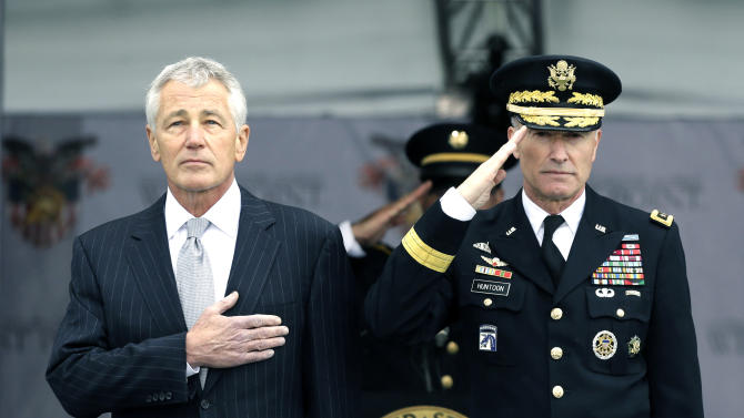 Defense Secretary Chuck Hagel, left, and Superintendent Lt. Gen. David Huntoon, Jr., stand for the national anthem during a graduation and commissioning ceremony at the U.S. Military Academy in West Point, N.Y. on Saturday, May 25, 2013. (AP Photo/Mike Groll)