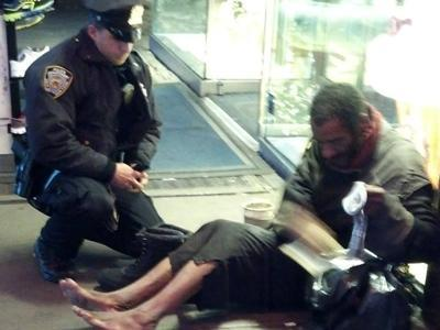 NYPD officer gives boots to homeless man