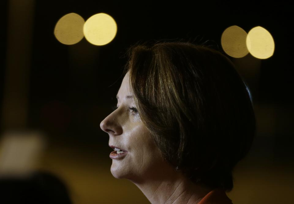 Australian Prime Minister Julia Gillard talks to reporters soon after her arrival at the APEC summit in Vladivostok, Russia, Friday, Sept. 7, 2012. (AP Photo/Mark Baker)