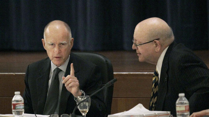 Gov. Jerry Brown, left, talks with University of California President Mark Yudof at the UC Board of Regents meeting in San Francisco, Wednesday, Nov. 14, 2012. (AP Photo/Jeff Chiu)