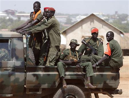SPLA soldiers drive in a vehicle in Juba