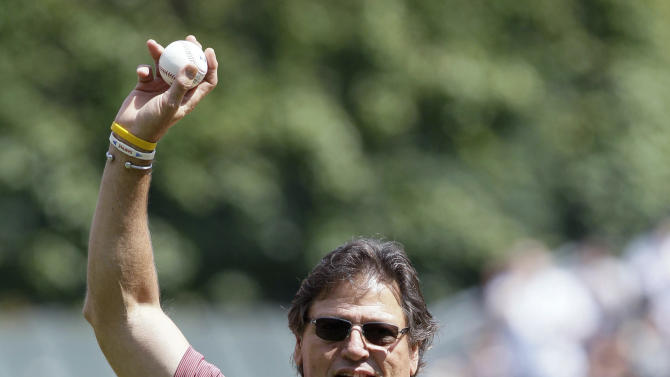 FILE - In this June 2, 2012, file photo, Hall of Fame catcher Carlton Fisk waves to the crowd before throwing the ceremonial first pitch before a baseball game between the Chicago White Sox and the Seattle Mariners in Chicago. Fisk has been charged with driving under the influence after he was found asleep in his pickup truck in an Illinois cornfield. New Lenox police say officers found the 64-year-old Fisk asleep on Monday night, Oct. 22, 2012, behind the wheel of his truck and an open liquor bottle on the floor. (AP Photo/Nam Y. Huh, File)