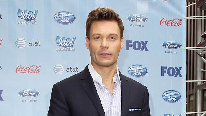 """This image released by Starpix shows Ryan Seacrest during a news conference for """"American Idol"""", Friday, March 1, 2013, to kick of the """"Idol Across America,"""" a promotion in New York. (AP Photo/Starpix, Kristina Bumphrey)"""