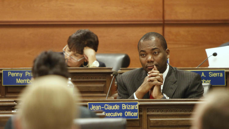 Chicago Public Schools CEO Jean-Claude Brizard listens to a presentation at a Chicago Board of Education meeting on Wednesday, Aug. 22, 2012 in Chicago. (AP Photo/Sitthixay Ditthavong)