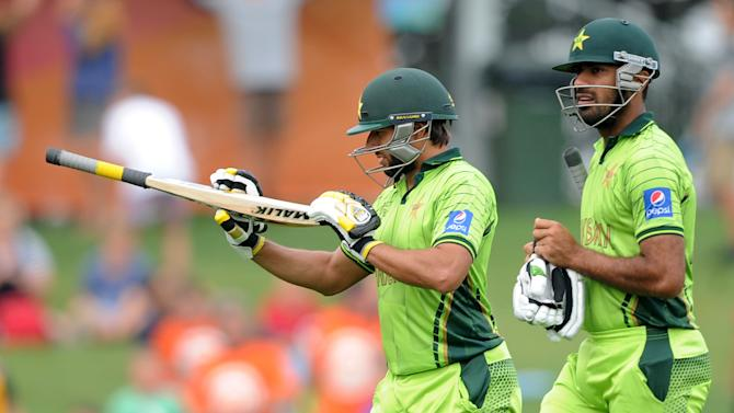 Pakistan's Shahid Afridi and teammate Wahab Riaz walk from the field at the end of their innings during their Cricket World Cup Pool B match against the United Arab Emirates in Napier, New Zealand, Wednesday, March 4, 2015. (AP Photo Ross Setford)