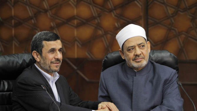 Iran's President Mahmoud Ahmadinejad, left, shakes hands with Grand Sheik Ahmed al-Tayeb, the head of Al-Azhar, the Sunni Muslim world's premier Islamic institution during their meeting at Al Azhar headquarters in Cairo, Egypt, Tuesday, Feb. 5, 2013. Once close, Egypt and Iran severed their relations after the 1979 Islamic Revolution when Cairo offered exile to Iran's deposed shah. Relations further deteriorated after Egypt's peace treaty with Israel. (AP Photo/Amr Nabil)