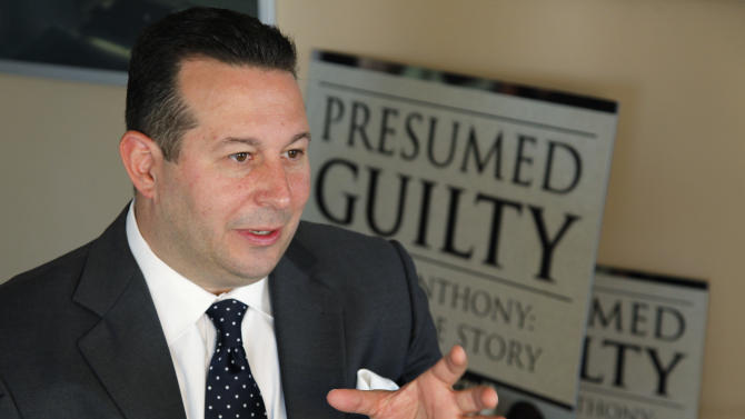 "In this Tuesday, July 3, 2012 photo, Casey Anthony's defense attorney, Jose Baez, gestures as he speaks during an interview with The Associated Press in Coral Gables, Fla. In his just-published book ""Presumed Guilty, Casey Anthony: The Inside Story,"" Baez said prosecutors offered in 2008 to allow Anthony to plead guilty to aggravated manslaughter of a child and serve up to 13 years in prison. Baez said that in those early days he thought taking it might be in Anthony's best interest. (AP Photo/Wilfredo Lee)"