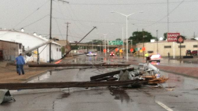This photo provided by Mark Sarlo shows debris covering the streeet after severe weather passed through the area on Monday, June 17, 2013 in La Junta, Colo.   National Weather Service spokeswoman Nezette Rydell said the tornado knocked down power poles in an industrial park near La Junta on Monday, but no injuries have been reported. More storms are expected on Tuesday. La Junta Fire Chief Aaron Eveatt said high winds raked the city, knocking down power poles in town and forcing the closure of a U.S. Highway 50, a main highway.  (AP Photo/Mark Sarlo)