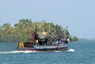 A Filipino-owned fishing boat sets off for a fishing expedition near the Scarborough Shoal from the coastal town of Masinloc, near Manila, on May 10. Philippine President Benigno Aquino convinced protesters to abort plans to sail Friday to a disputed South China Sea shoal as he sought ways to resolve a tense stand-off with China