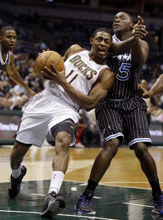 Milwaukee Bucks' Brandon Knight (11) drives against Orlando Magic's Victor Oladipo (5) during the second half of an NBA basketball game, Monday, March 10, 2014, in Milwaukee