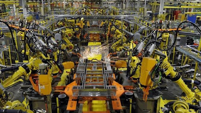 Robotic arms spot welds on the chassis of a Ford Transit Van under assembly at the Ford Claycomo Assembly Plant in Claycomo