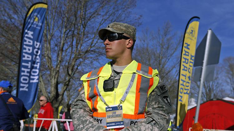 A military policeman stands near the start line of the 118th Boston Marathon Monday, April 21, 2014 in Hopkinton, Mass. (AP Photo/Michael Dwyer)