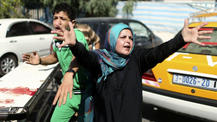 Relatives of three Palestinian children from Al-Rifi react outside a hospital morgue in Gaza City