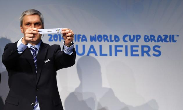 Savic head of FIFA World Cup Qualifiers displays name of France during draw for 2014 World Cup European qualifying playoffs in Zurich