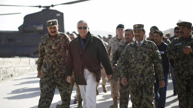 U.S. Secretary of Defense Chuck Hagel, second left, walks with Afghan Brig. Gen. Aminullah Patyani, left, commander of the Kabul Military Training Center, upon his arrival at the facility in Kabul, Afghanistan, Sunday, March 10, 2013. Hagel is on his first trip to Afghanistan as defense secretary. (AP Photo/Jason Reed, Pool)