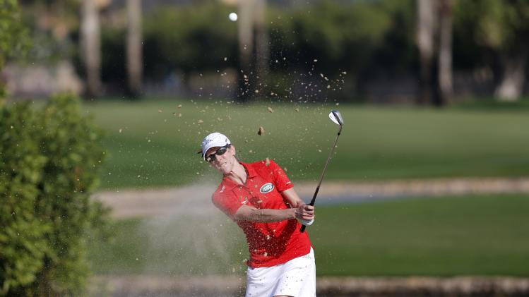 Luna of Italy hits the ball out of the bunker on the 14th hole during Dubai Ladies Masters golf tournament in Dubai