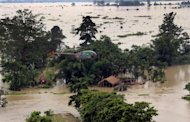A Press Information Bureau photo shows an Indian Air Force helicopter on a Relief and Rescue mission in the flood-affected areas of Assam. India's agriculture minister has warned the annual monsoon, which is crucial to the country's economy, is 31% below average but he says increased rainfall is forecast