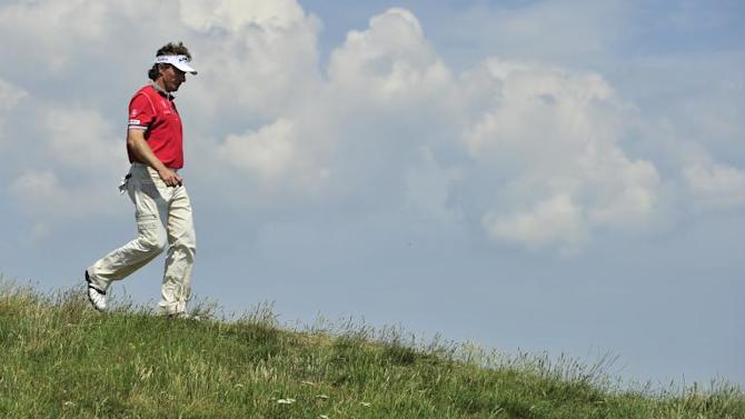 German golfer Bernard Langer walks off the 10th green, on the second day of the 140th British Open Golf championship at Royal St George's in Sandwich, Kent, south east England, on July 15, 2011