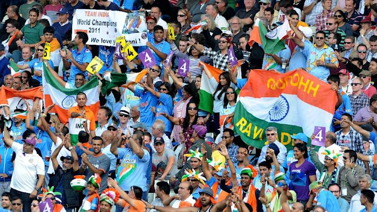 India cricket fans support their team during the fourth One Day International match between England and India at Edgbaston cricket ground, Birmingham, England, Tuesday, Sept 2, 2014. (AP Photo/Rui Vieira)