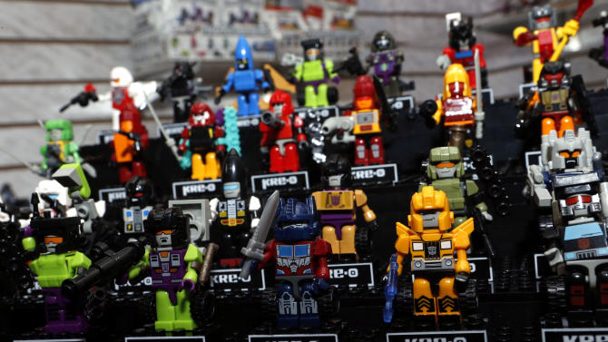"""""""KRE-O Transformers Beast Hunters Micro Changers,"""" which can be built in either robot or alternate battle mode, are displayed in Hasbro's showroom at the American International Toy Fair, Friday, Feb. 8, 2013, in New York. (Photo by Jason DeCrow/Invision for Hasbro/AP Images)"""
