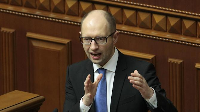 Ukrainian Prime Minister Arseniy Yatsenyuk, speaks to lawmakers during a session at the Ukrainian parliament in Kiev, Ukraine, Thursday, March. 27, 2014. (AP Photo/Sergei Chuzavkov)