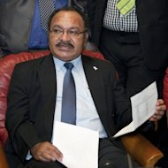 PNG Prime Minister Peter O'Neill, pictured in 2011. O'Neill claimed the judiciary was biased and rejected the decision, which led Thursday to Deputy Prime Minister Belden Namah and 10 police storming into the court to arrest Chief Justice Sir Salamo Injia
