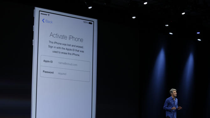 Craig Federighi, senior vice president of Software Engineering at Apple demonstrates the new activation lock security feature in iOS 7 during the keynote address of the Apple Worldwide Developers Conference Monday, June 10, 2013 in San Francisco. (AP Photo/Eric Risberg)