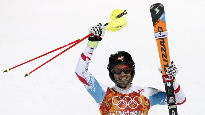 Austria's Mario Matt celebrates winning the gold medal in the men's slalom at the Sochi 2014 Winter Olympics, Saturday, Feb. 22, 2014, in Krasnaya Polyana, Russia. (AP Photo/Christophe Ena)