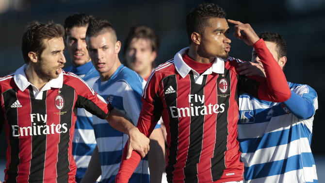 CORRECTS YEAR DATE FROM 2012 TO 2013. AC Milan Ghana midfielder Kevin-Prince Boateng, right, is flanked by his teammate Mathieu Flamini as he gestures towards the crowd in Busto Arsizio, near Milan, Italy, Thursday, Jan. 3, 2013. A friendly match between AC Milan and lower division club Pro Patria was abandoned Thursday after racist chants directed at Milan's black players, the latest incident of racial abuse that continues to blight the sport. After repeated chants directed his way, Ghana midfielder Kevin-Prince Boateng picked up the ball and kicked it at a section of the crowd in the 26th minute of the first half. Boateng then took off his shirt and walked off the pitch with his Milan teammates. Urby Emanuelson, Sulley Muntari and M'Baye Niang were also targeted by the chants. (AP Photo/Emilio Andreoli)