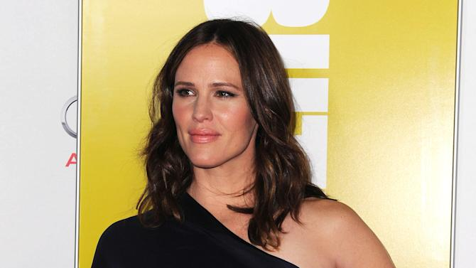 """Jennifer Garner arrives at the AFI special screening of """"Butter"""" at Grauman's Chinese Theater, Sunday, Nov. 6, 2011, in Los Angeles. (AP Photo/Katy Winn)"""