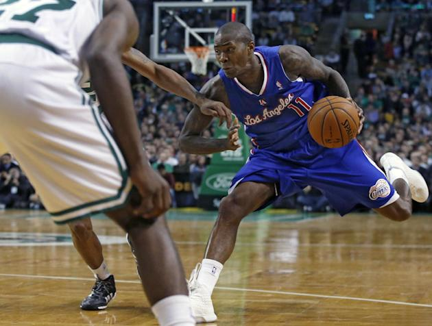 Los Angeles Clippers guard Jamal Crawford (11) dribbles against the Boston Celtics in the second half of an NBA basketball game in Boston, Wednesday, Dec. 11, 2013. The Clippers won 96-88