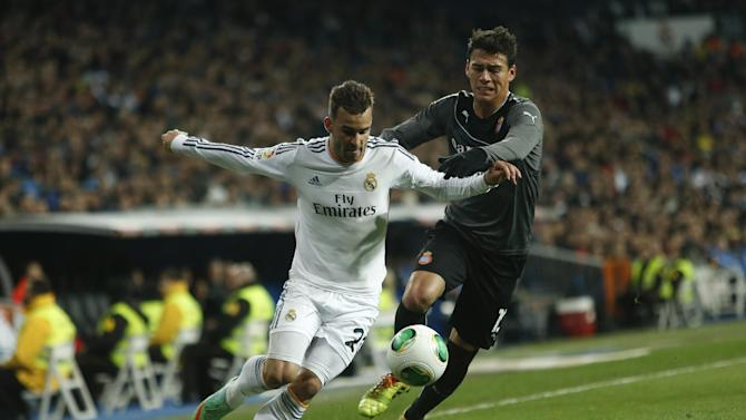 Real Madrid's Jese Rodriguez, left, in action with Espanyol's Hector Moreno during a Copa del Rey soccer match between Real Madrid and Espanyol at the Santiago Bernabeu stadium in Madrid, Spain, Tuesday, Jan. 28, 2014. (AP Photo/Andres Kudacki)