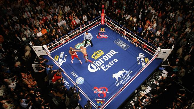 (R-L) Miguel Cotto Throws Getty Images