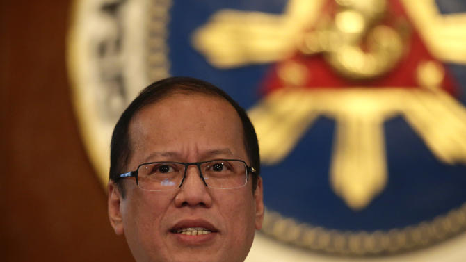 "Philippine President Benigno Aquino III talks about the current standoff between a Filipino Muslim clan, who occupied a village in Lahad Datu, Sabah State in Malaysia, and Malaysian forces during a news conference at Malacanang Palace in Manila Monday March 4, 2013 in Manila, Philippines. The standoff resulted in a firefight Friday and Sunday that resulted in the death of at least ten of the Sulu Sultanate ""Royal Army"" followers and two Malaysian forces. Malaysia sent hundreds of soldiers to a Borneo state Monday to help neutralize armed Filipinos who allegedly have killed 8 police officers in the country's bloodiest security emergency in years. (AP Photo/Bullit Marquez)"