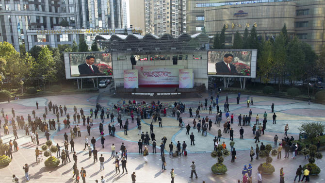 People gather at a park watching TV live broadcast of China's new Communist Party General Secretary Xi Jinping speaking during a press event to introduce the newly-elected members of the Politburo Standing Committee, in Shanghai, China, Thursday, Nov. 15, 2012. (AP Photo) CHINA OUT