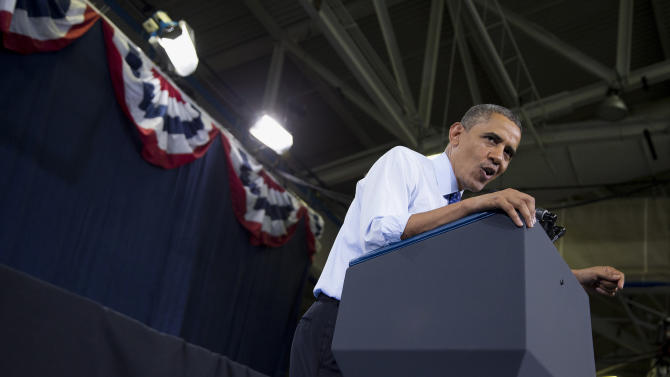 President Barack Obama speaks during a campaign rally for Massachusetts Democratic Senate candidate Rep. Ed Markey in Boston, Wednesday, June 12, 2013. Markey is competing against former Navy SEAL Republican candidate Gabriel Gomez. (AP Photo/Evan Vucci)