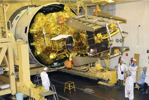 FILE  In this Nov.2, 2011 file photo distributed by Russian Roscosmos  space agency shows technicians  working on the Phobos-Ground probe .  Russia's space agency says the Phobos-Ground probe bound fo