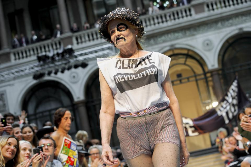 British designer Vivienne Westwood receives applause during London Fashion Week, Sunday, Sept. 16, 2012. (AP Photo/Jonathan Short)