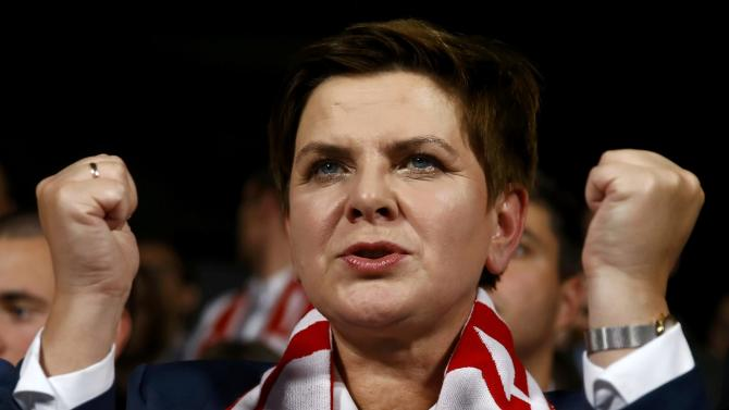 Polish main opposition party Law and Justice's candidate for prime minister Szydlo cheers Polish national team during the broadcast of UEFA Euro 2016 qualifying soccer match between Poland and Scotland in Warsaw