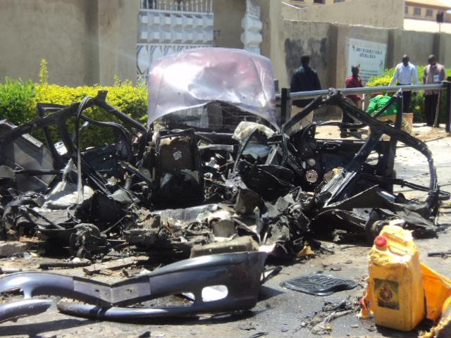 The remains of a car used in a suicide bombing outside a church in Bauchi, Nigeria. Sunday, Sept. 23, 2012.   A suicide car bomber attacked a Catholic church in northern Nigeria on Sunday, killing two people and wounding another 45, officials said. (AP Photo) EDS NOTE: BEST QUALITY AVAILABLE