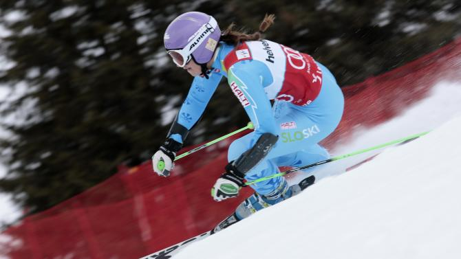 Tina Maze from Slovenia speeds down the course during the women's  giant slalom for the finals of the Alpine skiing World Cup in Lenzerheide, Switzerland, Sunday,March.17,2013.(AP Photo/Alessandro Trovati)