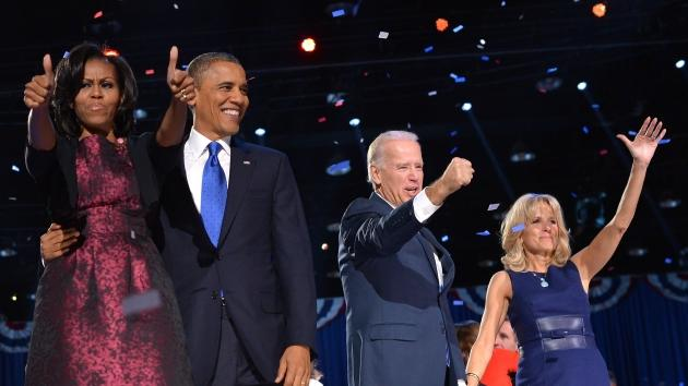 President Barack Obama flanked by First Lady Michelle Obama, and Vice-President Joe Biden and Second Lady Jill Biden wave to supporters following Obama's speech on election night November 6, 2012 in Chicago -- Getty Premium