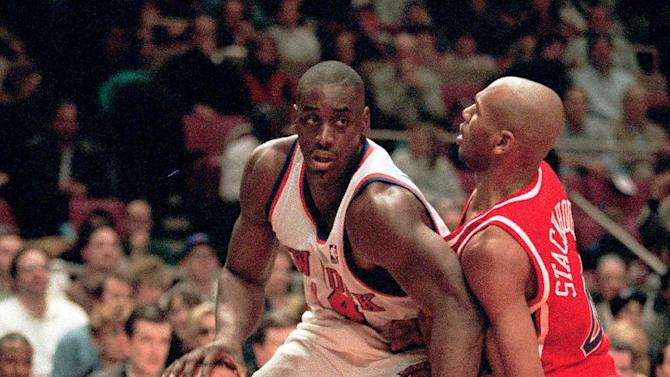 FILE - In this March 16, 1996 file photo, New York Knicks forward Anthony Mason, left, battles the defense of Philadelphia 76ers guard Jerry Stackhouse during first half of an NBA basketball game in New York. The New York Knicks spokesman Jonathan Supranowitz confirmed Saturday, Feb. 28, 2015 that Mason, a rugged power forward who was a defensive force for several NBA teams in the 1990s, has died. He was 48.  (AP Photo/Kevin Larkin)