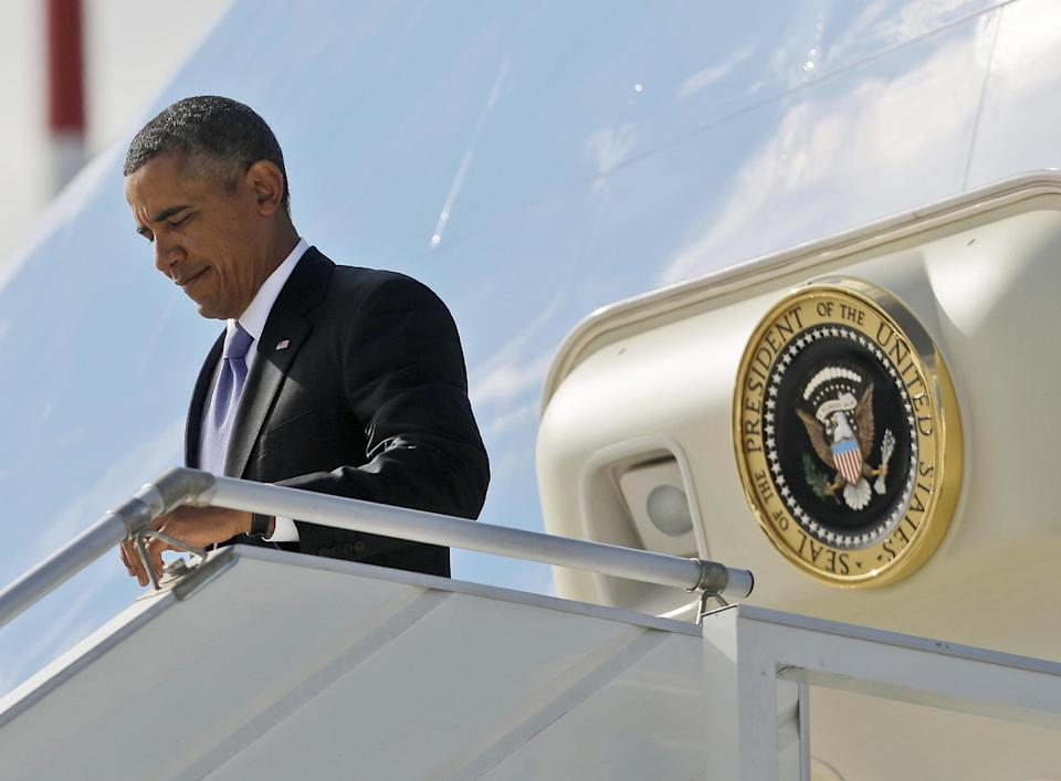 US President Barack Obama during his arrival at Pulkovo International Airport on Air Force One, Thursday, Sept. 5, 2013, in St. Petersburg, Russia. Obama traveled to Russia to attend the G20 Summit. (AP Photo/Pablo Martinez Monsivais)