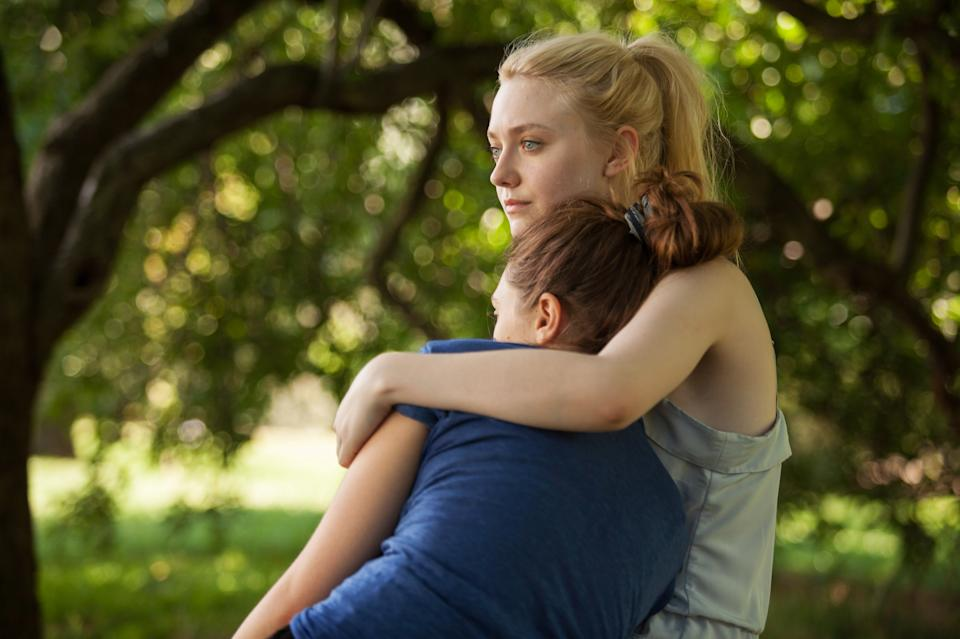 "This undated publicity film image provided by the Sundance Institute shows Dakota Fanning, right, and Elizabeth Olsen, in the film ""Very Good Girls,"" included in the narrative premieres at the 2013 Sundance Film Festival in January. (AP Photo/Sundance Institute, Jessica Miglio)"