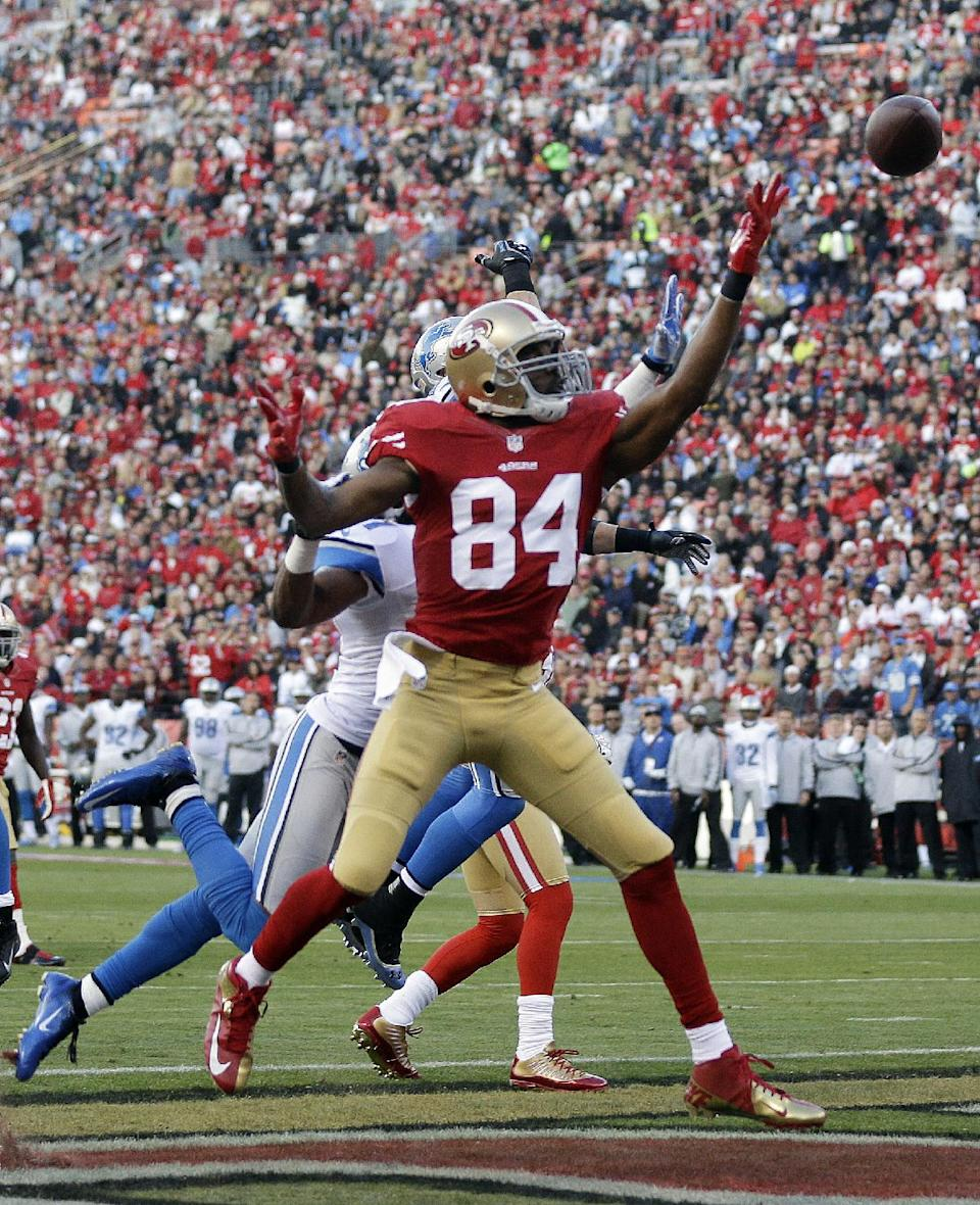 San Francisco 49ers wide receiver Randy Moss reaches for a pass, but Detroit Lions cornerback Jacob Lacey is called for interference on the play, during the first quarter of an NFL football game in San Francisco, Sunday, Sept. 16, 2012. (AP Photo/Marcio Jose Sanchez)