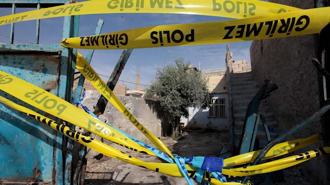 The destroyed entrance of the house where a Syrian mortar attack killed five people in Akcakale, Turkey, Thursday, Oct. 4, 2012. Turkey fired on Syrian targets for a second day Thursday,  but said it has no intention of declaring war, despite tensions after deadly shelling from Syria killed five civilians in a Turkish border town.(AP Photo)