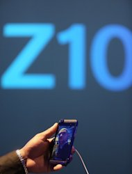 A worker demonstrates the Blackberry Z10's video feature at the BlackBerry 10 launch event at Pier 36 in Manhattan on January 30, 2013 in New York City. The smartphone maker BlackBerry confirmed Friday that it has no immediate plans to sell its new handsets in Japan, but the company denied it was abandoning one of the world's most tech-savvy nations