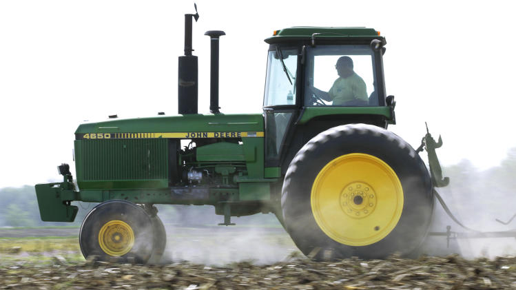 Deere earnings hit by slowing economic growth