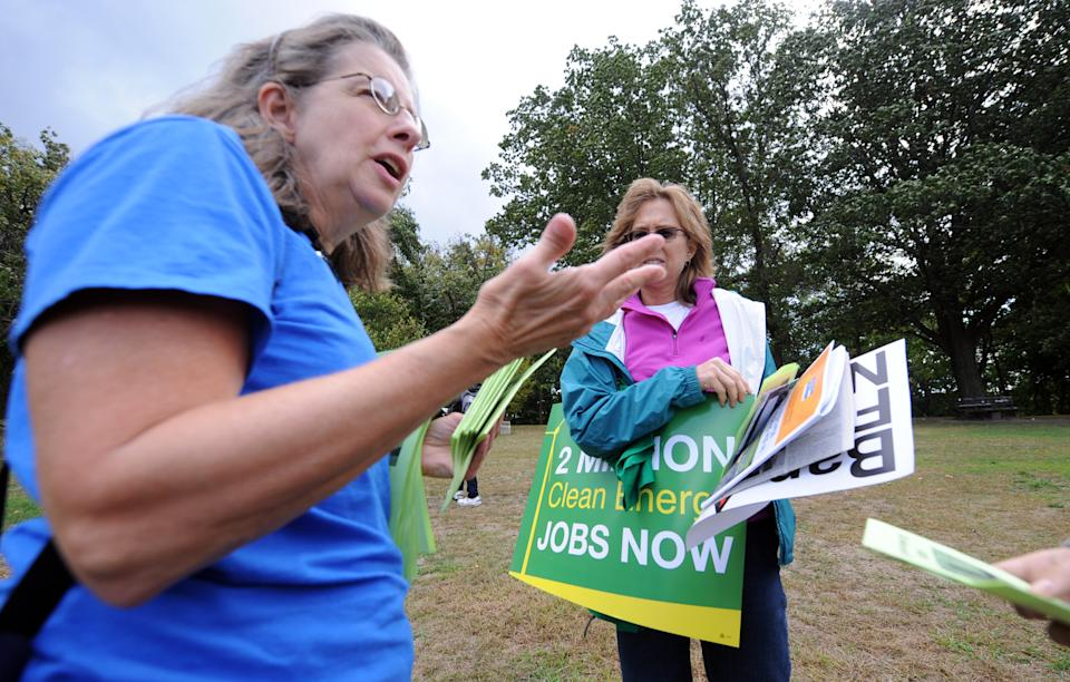 Cynthia Walter, from the Sierra Club, and other participants rallied and signed petitions in Schenley Park during a rally against Shale gas drilling in Pittsburgh, Saturday, Sept. 22, 2012.   (AP Photo/John Heller)